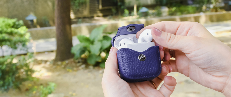 Airpods leather cases available in royal purple pebble grain leather
